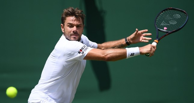 Wawrinka means business as he opens with easy victory in Wimbledon