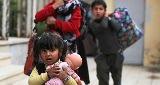 تركيا تقدم مساعدات إلى 1500 عائلة نازحة من الموصل