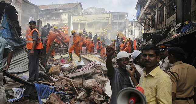 At least 21 dead, several others trapped after building collapses in India's Mumbai