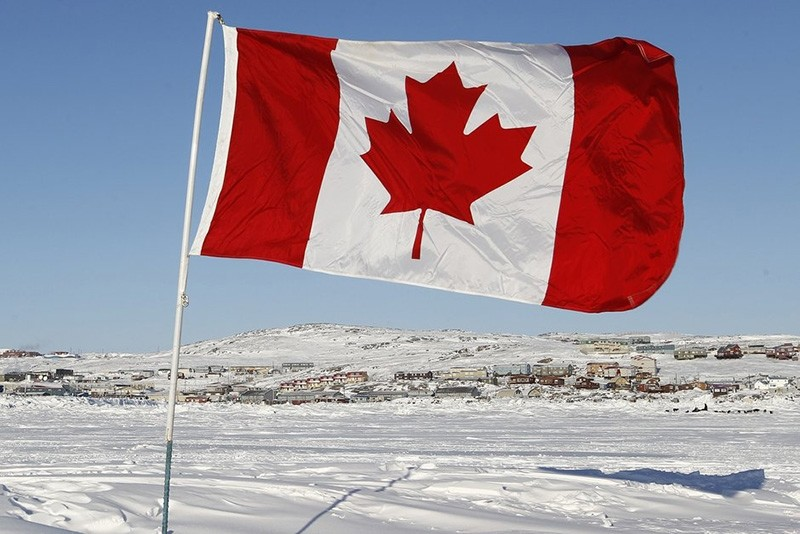 A Canadian flag is pictured on Frobisher Bay in Iqaluit, Nunavut February 23, 2012. (Reuters Photo)
