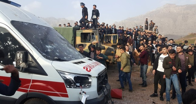 Protesters provoked by the PKK gather after storming a Turkish military camp near Dohuk, Iraq, Jan. 26, 2019.