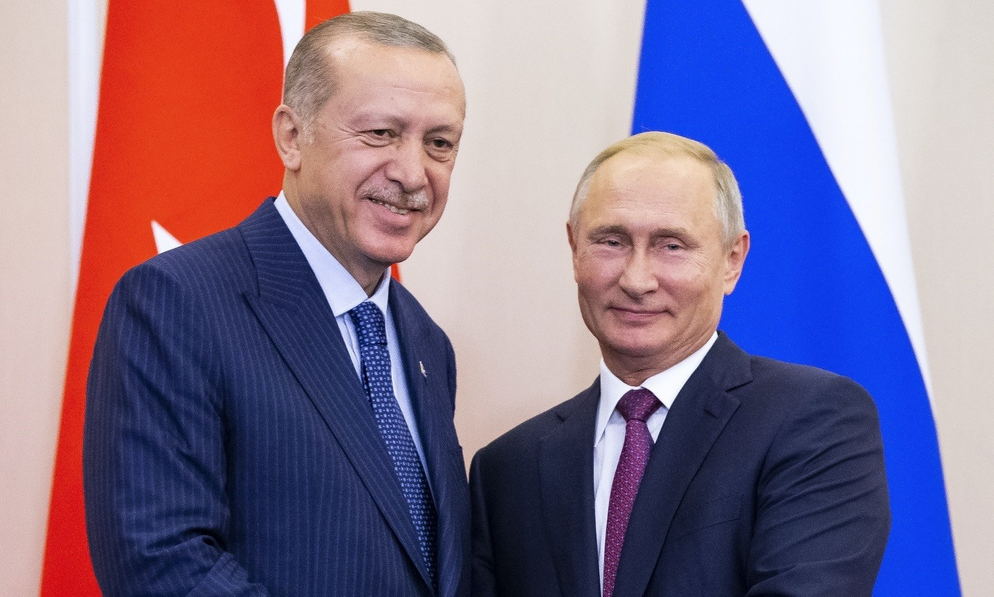 President Recep Tayyip Erdou011fan and his Russian counterpart Vladimir Putin shake hands during a news conference in Sochi, Sept. 17.