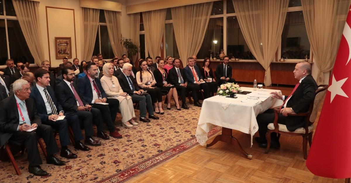 President Recep Tayyip Erdou011fan addresses accompanying Turkish journalists in Beijing, July 3, 2019.
