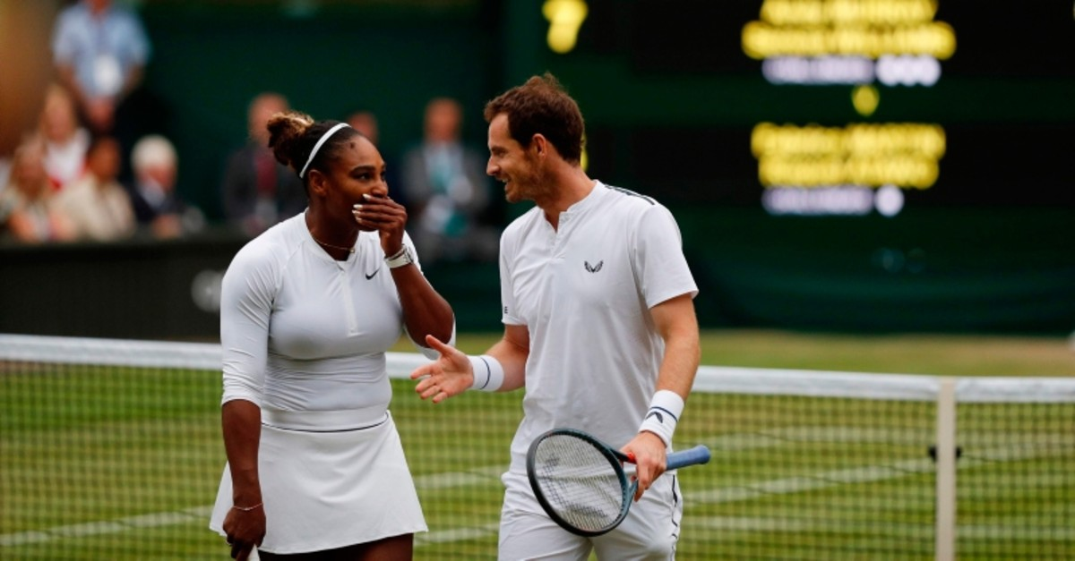 Britain's Andy Murray (R) and U.S. player Serena Williams (L) talk between points against France's Fabrice Martin and US player Raquel Atawo during their mixed doubles second round match on day eight of the 2019 Wimbledon Championships. (AFP Photo)