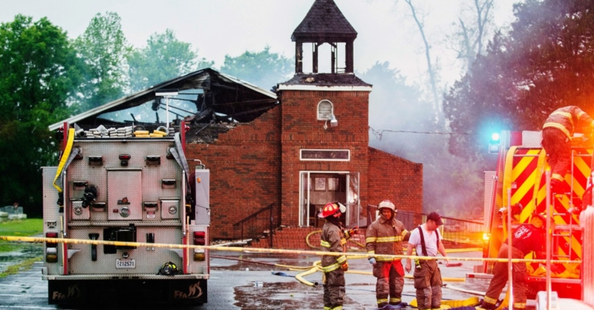 In this April 4, 2019 file photo, firefighters and fire investigators respond to a fire at Mt. Pleasant Baptist Church, in Opelousas, La. (AP Photo)