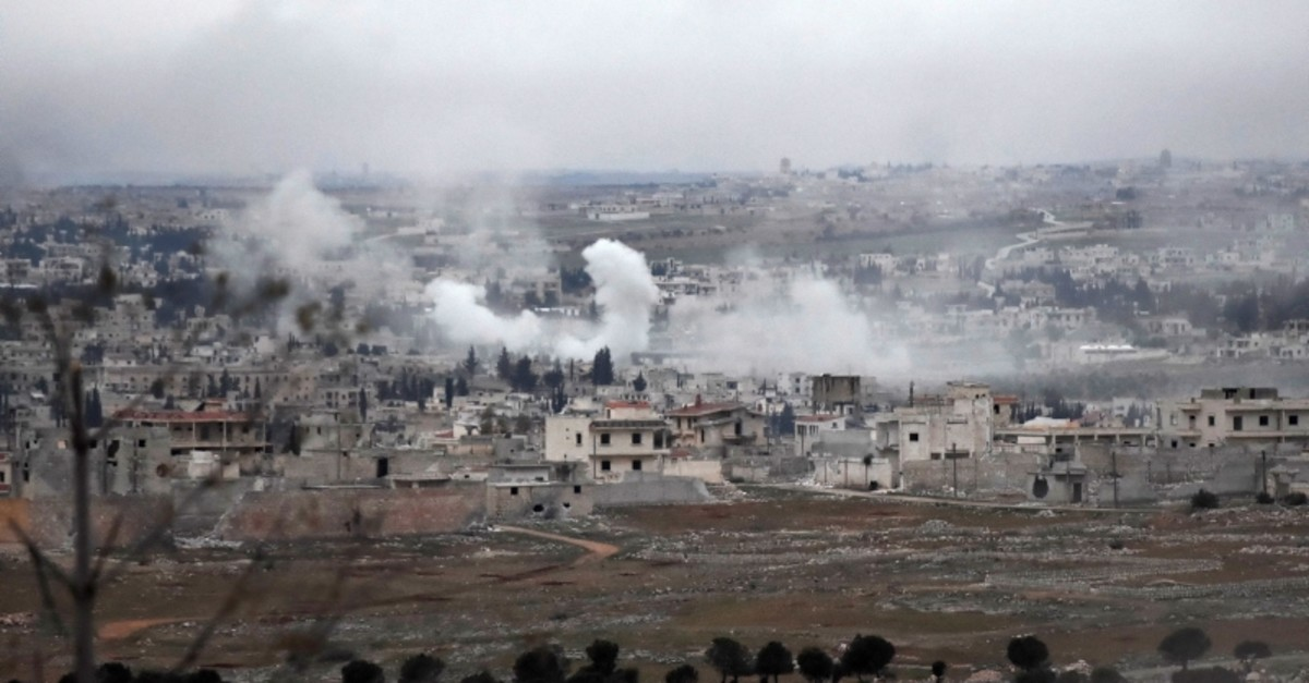 Smoke from Assad regime forces shelling is pictured over Khan al-Asal in the Rashideen al-Rabea area in Syria's Aleppo province on Feb. 11, 2020 (AFP Photo)