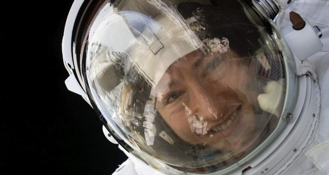 This handout photo released by NASA on Feb. 4, 2020, shows NASA astronaut Christina Koch during a spacewalk on Jan. 15, 2020. NASA handout photo via AFP