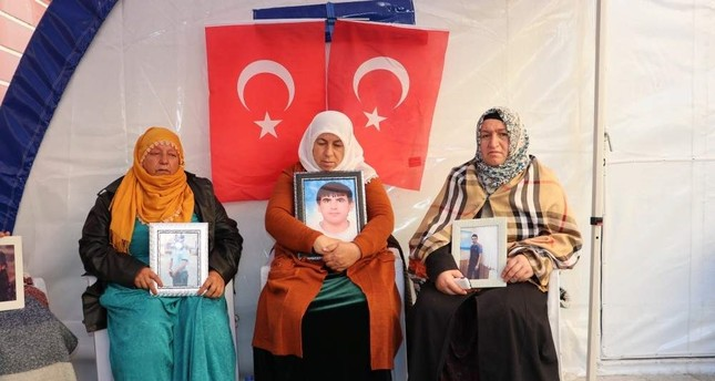 Mothers hold pictures of their children abducted by the PKK terrorist group during a sit-in protest at the pro-PKK Peoples' Democratic Party (HDP) headquarters in Diyarbak?r, Nov.16, 2019. AA
