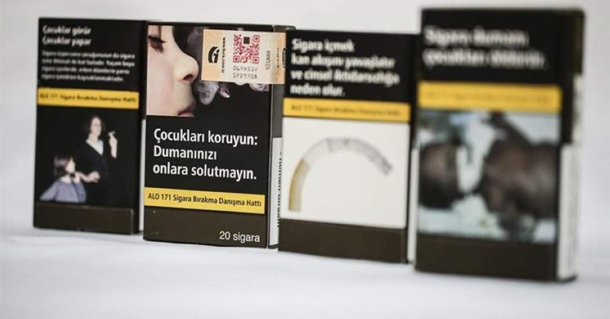 Flashy and colorful brand names were replaced by warning texts and pictures in the new plain packaging for cigarettes. (AA Photo)