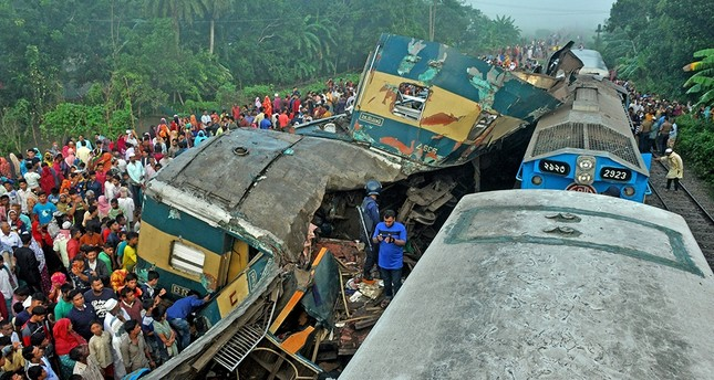 Rescue workers and people gather beside the remains of a damage passenger train in Kasba Upazila, Brahmanba district, Bangladesh, 12 November 2019. (EPA Photo)