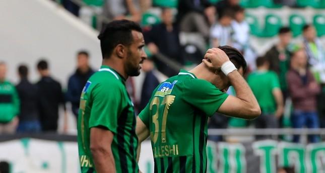 Akhisarspor players Sokol Chikalleshi and Sergio Borges (L) walk in frustration after a 2-0 loss to Evkur Yeni Malatyaspor, May 5, 2019.