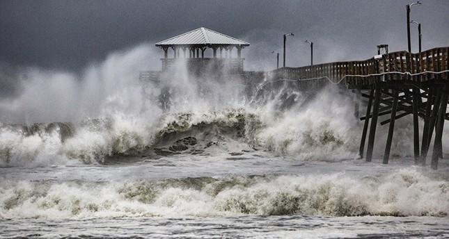 Waves slam the Oceana Pier & Pier House Restaurant in Atlantic Beach, N.C., Thursday, Sept. 13, 2018, as Hurricane Florence approaches the area. (AP Photo)