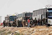Syrian opposition fighters leave town near Douma
