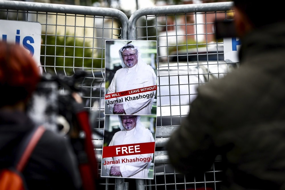 Posters protesting Jamal Khashoggi's disappearance seen on the police barricades around the Saudi Consulate in Istanbul during demonstrations, Oct.14.