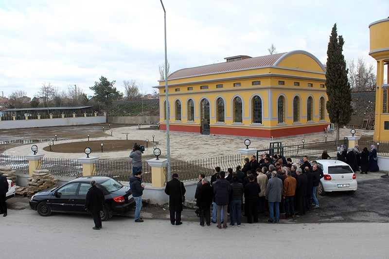 People protest the construction of banquet hall on top of historical cemetery site (IHA Photo)