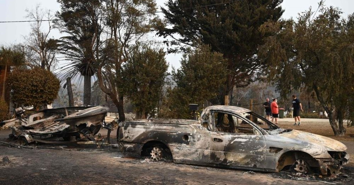 Vehicles gutted by bushfires are seen in the town of Lake Conjola, New South Wales, Jan. 1, 2020. (AFP Photo)