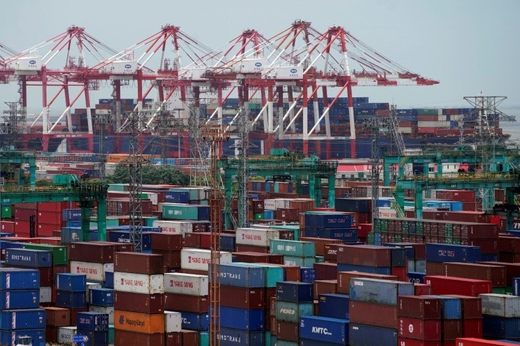 Shipping containers are seen at a port in Shanghai, China, July 10, 2018.