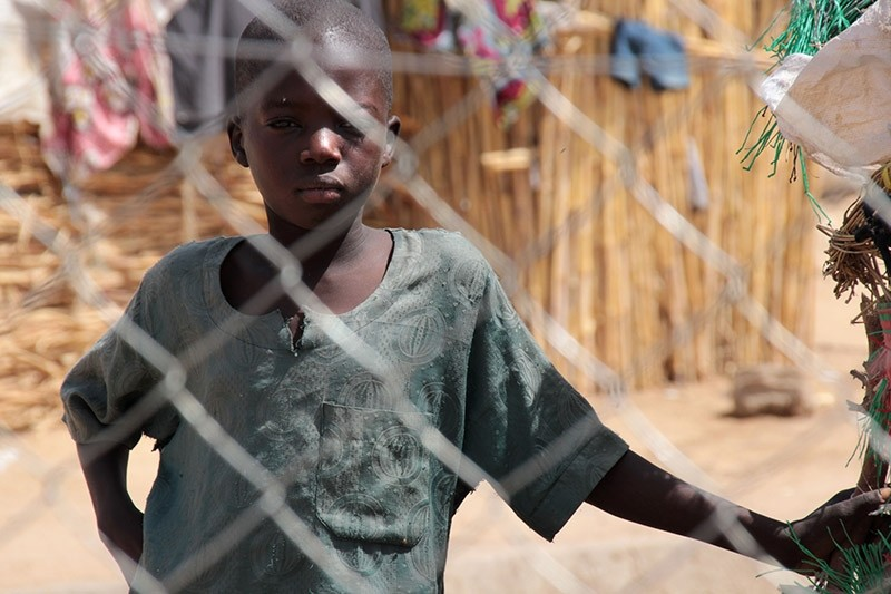 A handout photo released by the World Food Programme (WFP) shows a boy at the Pompomari camp in Damaturu on January 26, 2017 during a visit by the WFP executive director. (AFP Photo)