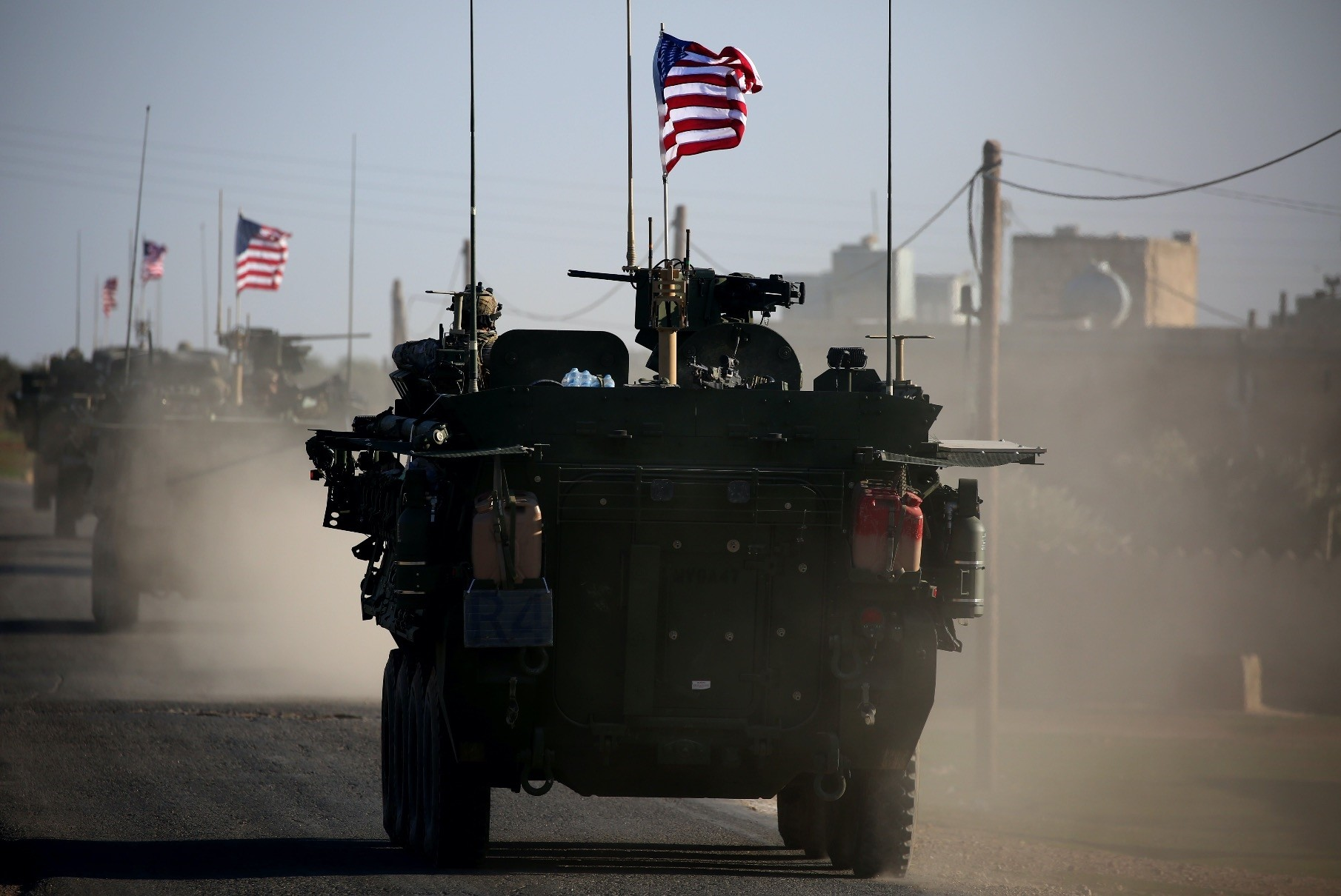 A US military vehicle= drives near the village of Yalanli, on the western outskirts of the northern Syrian city of Manbij, on March 5, 2017.