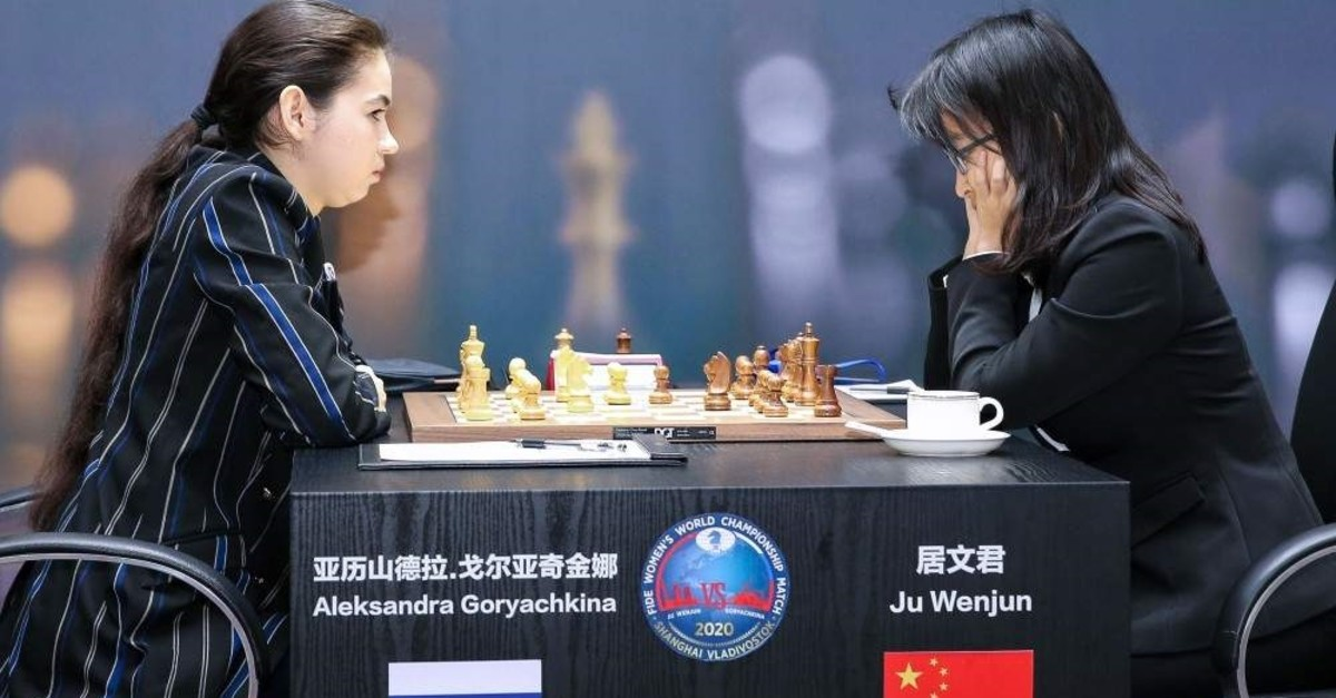 Wenjun (R) competing against Goryachkina (L) during the 202 FIDE Women's World Chess Championship in Shanghai, Jan. 5, 2020. (AFP Photo)