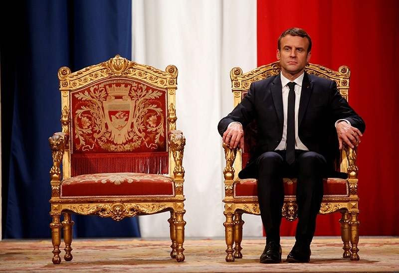 French President Emmanuel Macron listens as Paris Mayor Anne Hidalgo delivers her speech during a ceremony at the Hotel de Ville in Paris, France, May 14, 2017. (Reuters Photo)