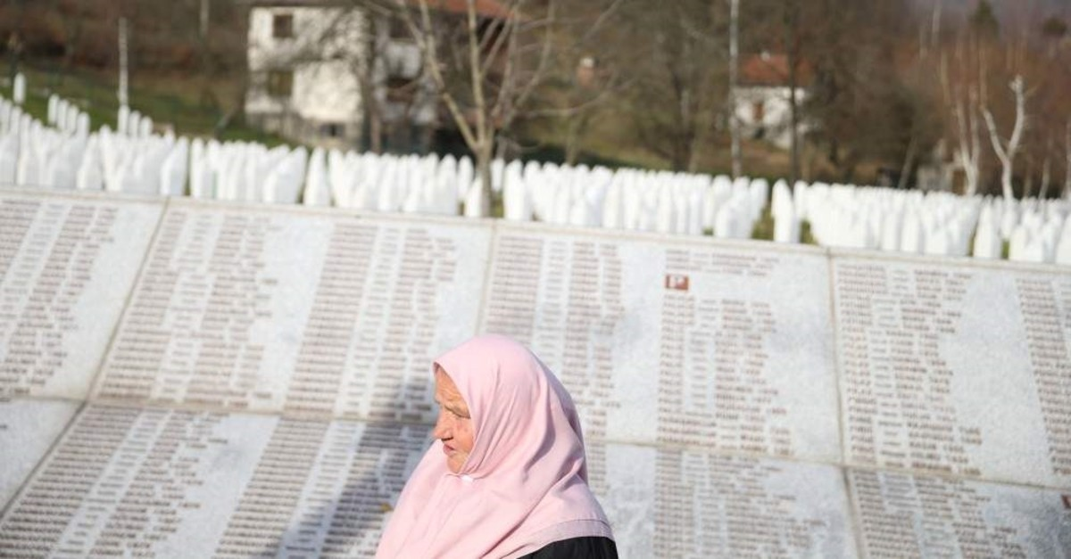 A woman walks past the Memorial plaque with the names of people killed in the Srebrenica massacre at the Memorial center Potocari near Srebrenica, Bosnia and Herzegovina, Nov. 22, 2017. (Reuters Photo)