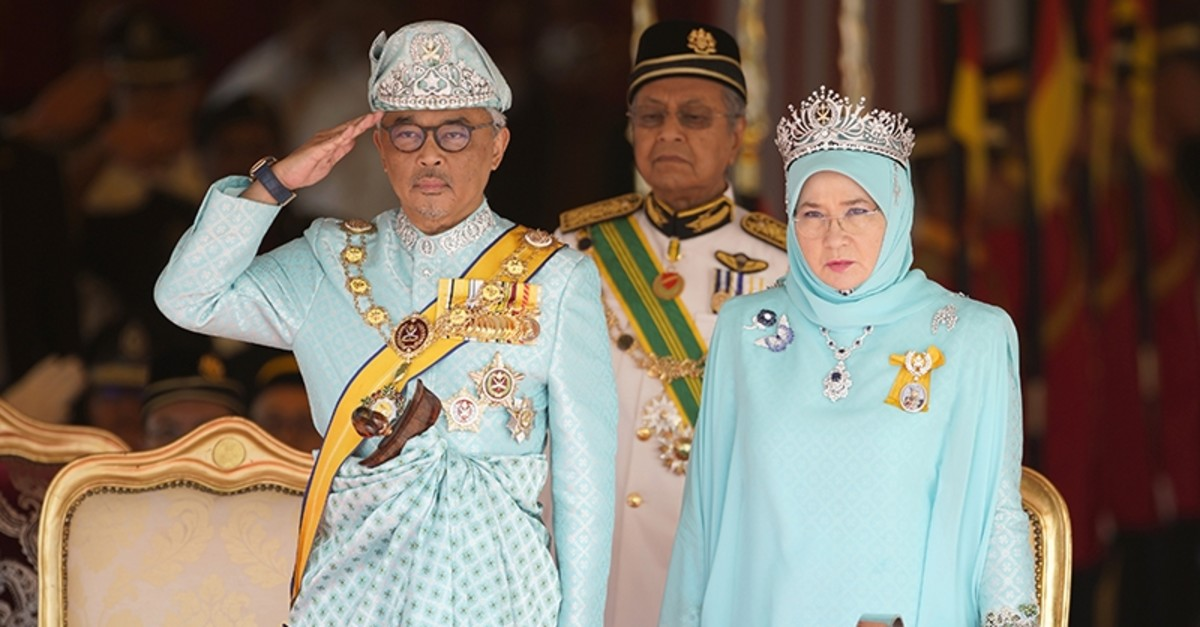Malaysia's King Sultan Abdullah Sultan Ahmad Shah salutes next to Queen Tunku Azizah Aminah Maimunah and Prime Minister Mahathir Mohamad, center, during his welcome ceremony at Parliament House in Kuala Lumpur, Malaysia, Jan. 31, 2019. (AP Photo)