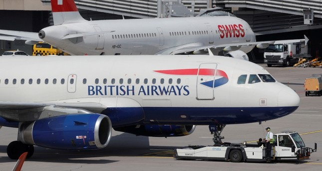 An aircraft of British Airways airlines is pulled by a Goldhofer pushback tractor of air service provider DNATA at Zurich airport, Switzerland April 16, 2019.  Picture taken April, 16, 2019 (Reuters Photo)
