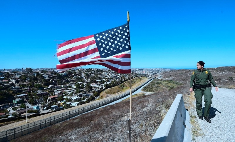 In this file photo taken on April 17, 2018 a US Customs and Border Protection agent patrols from within the Border Infrastructure System, which separates California from Mexico in San Diego, California. (AFP Photo)