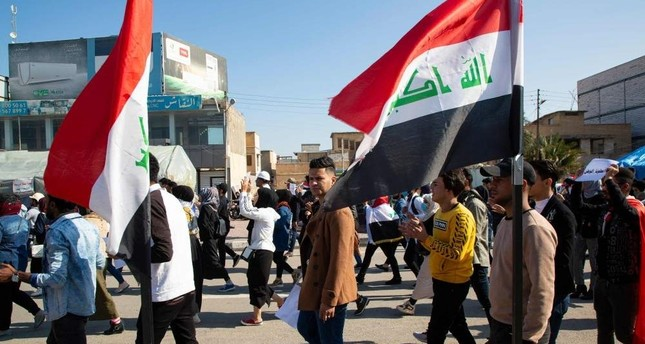 Iraqi students take part in an anti-government demonstration near the headquarters of the local government, Basra, Jan. 23, 2020. AFP Photo