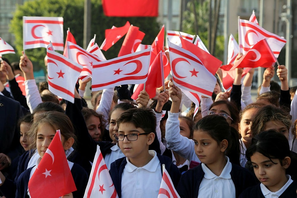 Children holding flags of the Turkish Republic of Northern Cyprus and Turkey during celebrations of the former's 34th anniversary of independence declaration, Nicosia, Turkish Republic of Northen Cyprus, Nov. 15, 2017. (AA Photo)
