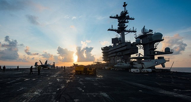 A handout photo made available by the US Navy shows the aircraft carrier USS Carl Vinson (CVN 70) as it transits the South China Sea, 08 April 2017 (issued 10 April 2017). (EPA Photo)