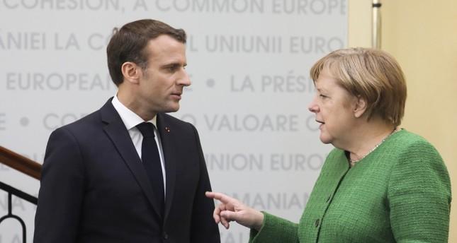 المستشارة الألمانية انغيلا ميركل مع الرئيس الفرنسي إيمانويل ماكرون (الفرنسية)