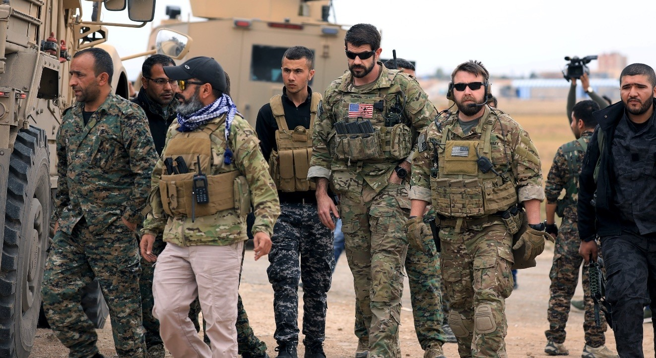 YPG militants and U.S. troops are seen together during a patrol near the Turkish border in Hasakah, Nov. 4.
