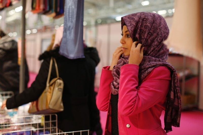A visitor trying on a hijab at the Annual Meeting of France's Muslims in 2015, north of Paris.