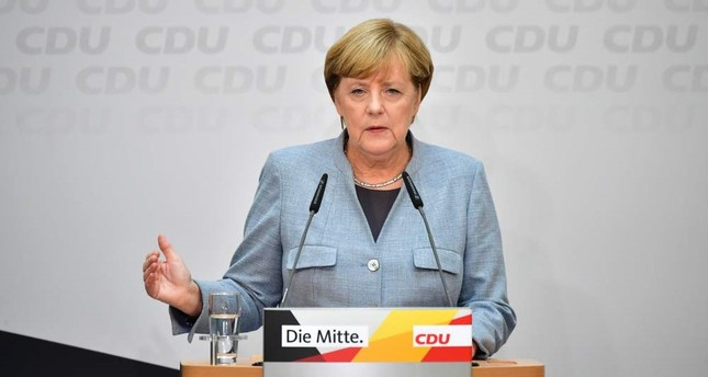 German Chancellor Angela Merkel attends a press conference at the headquarters of the Christian Democratic Union (CDU) party in Berlin yesterday.