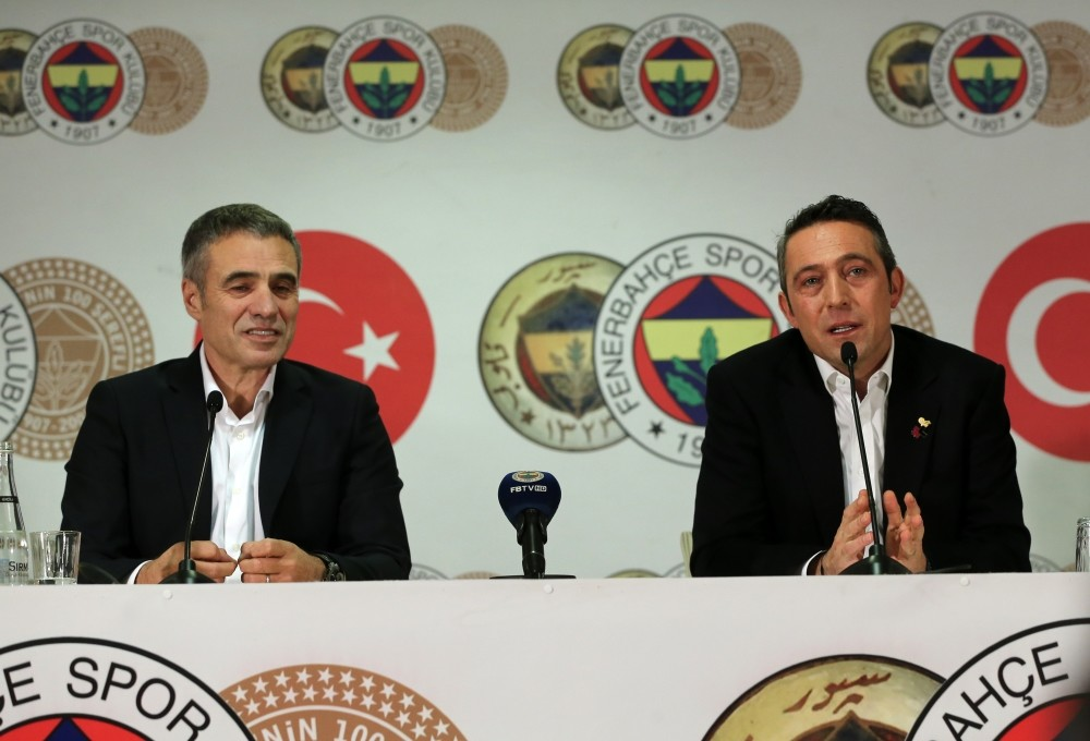 Ersun Yanal (L) and Ali Kou00e7 speak at a press conference and signing ceremony, Dec. 18.