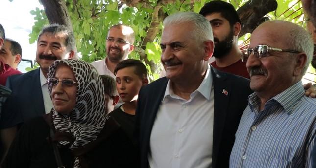 The People's Alliance Istanbul mayoral candidate Binali Yıldırım speaks with citizens in the Küçükçekmece district, June 18, 2019.