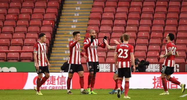 Sheffield United players celebrate their second goal in front of empty seats during the FA Cup third round match against Fylde, Jan. 5, 2020. AFP Photo