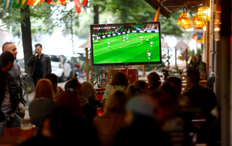 Football fans watch 2018 World Cup Group F match between Germany and Sweden in front of a pub in Berlin, Germany, June 23, 2018. (Reuters Photo)