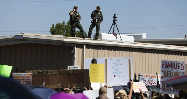 A crowd protests outside the U.S. Immigration and Customs Enforcement processing center in El Paso, Texas, in June 2018. (AP Photo)