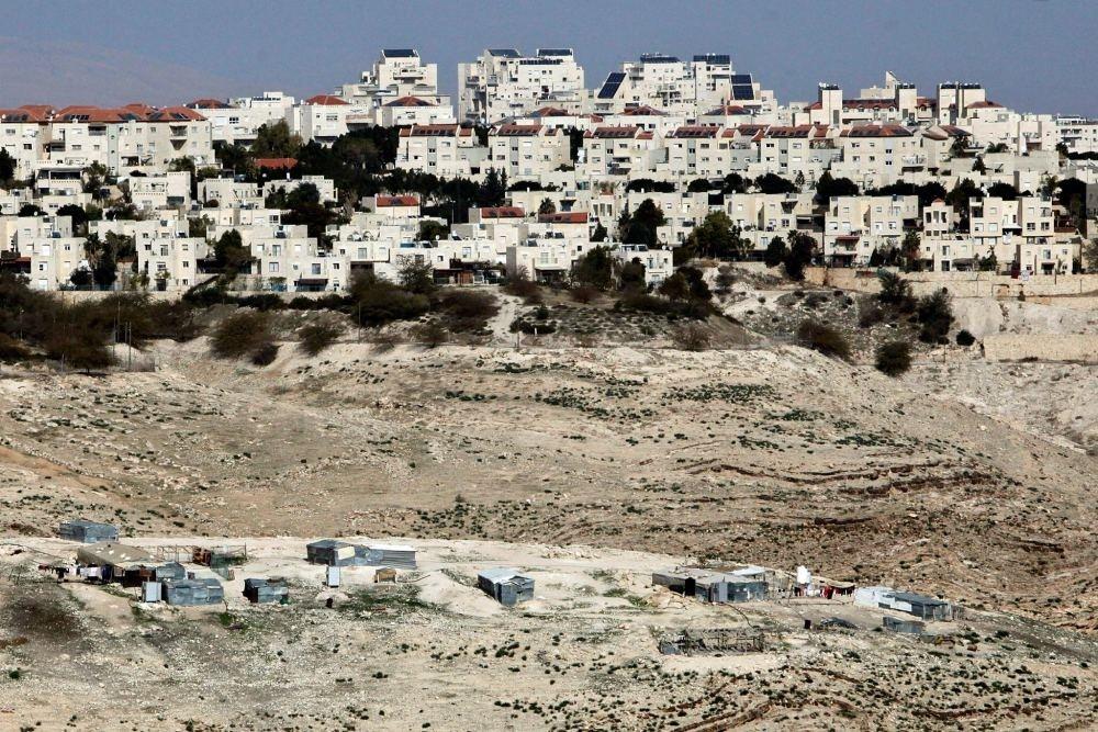 The Israeli settlement of Maaleh Adumim looms over Arab Bedouin shacks in the West Bank.