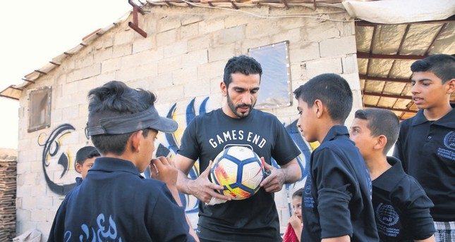 Qatari midfielder Adel Lamy joined a group of Syrian refugee children for a game of football in Hatay.