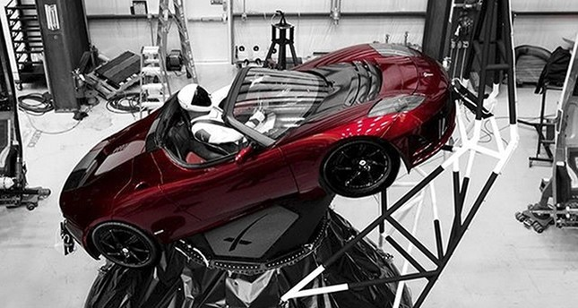 A mannequin Starman sits at the wheel of a Tesla Roadster in this photo posted on the Instagram account of Elon Musk, head of auto company Tesla and founder of the private space company SpaceX (AP Photo)