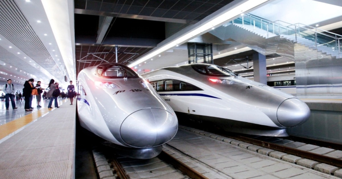 A new high-speed inter-city train that connects Shanghai and Hangzhou waits for passengers prior to the first train's launch in Shanghai, China, on Tuesday, Oct. 26, 2010. (FILE Photo/BLOOMBERG)