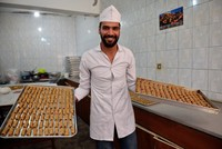 Syrian pastry chef earns living by mixing region's flavors
