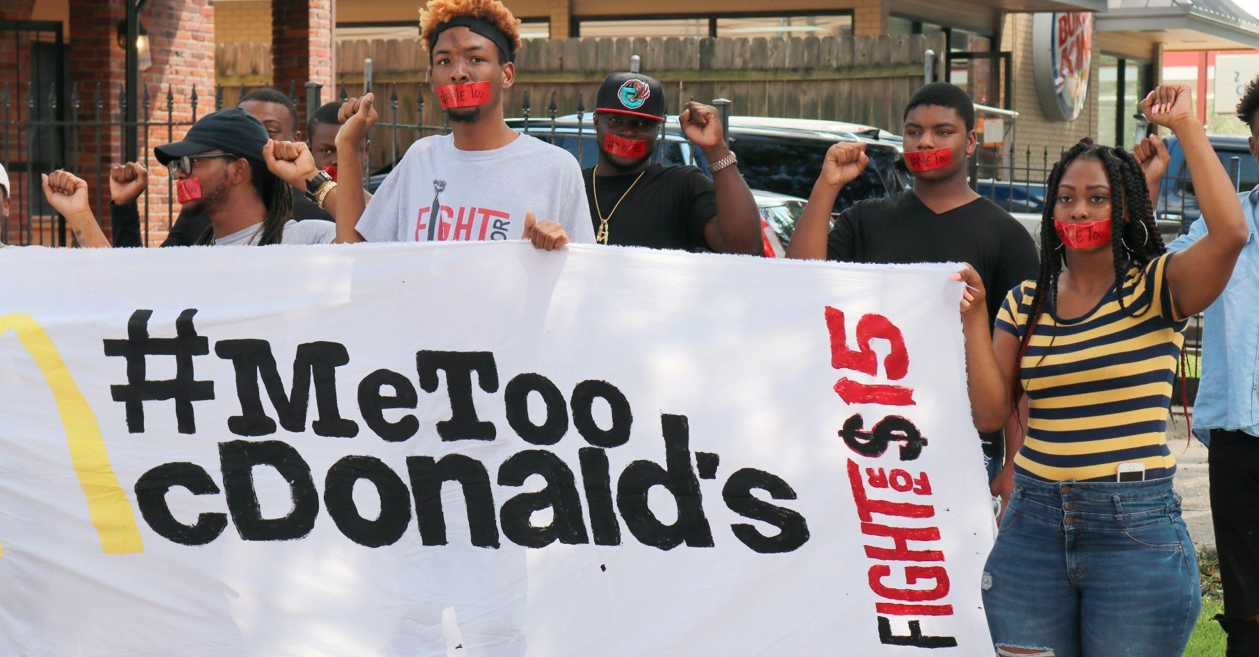 Current and former McDonaldu2019s employees wear tape with u201c#MeToou201d over their mouths as they walk up to one of their restaurants to a protest in New Orleans, Sept. 18.