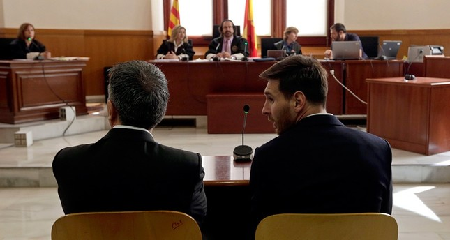 Barcelona's Lionel Messi, right, and his father Jorge Horacio Messi sit in court in Barcelona, Spain, Thursday June 2, 2016.emAP Photo/em