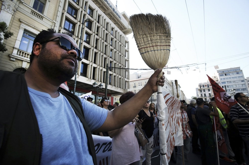 Municipal contract workers from all over Greece protest outside the Interior Ministry in Athens. The union of municipality workers launched a 48-hour strike to protest over changes affecting their contracts.