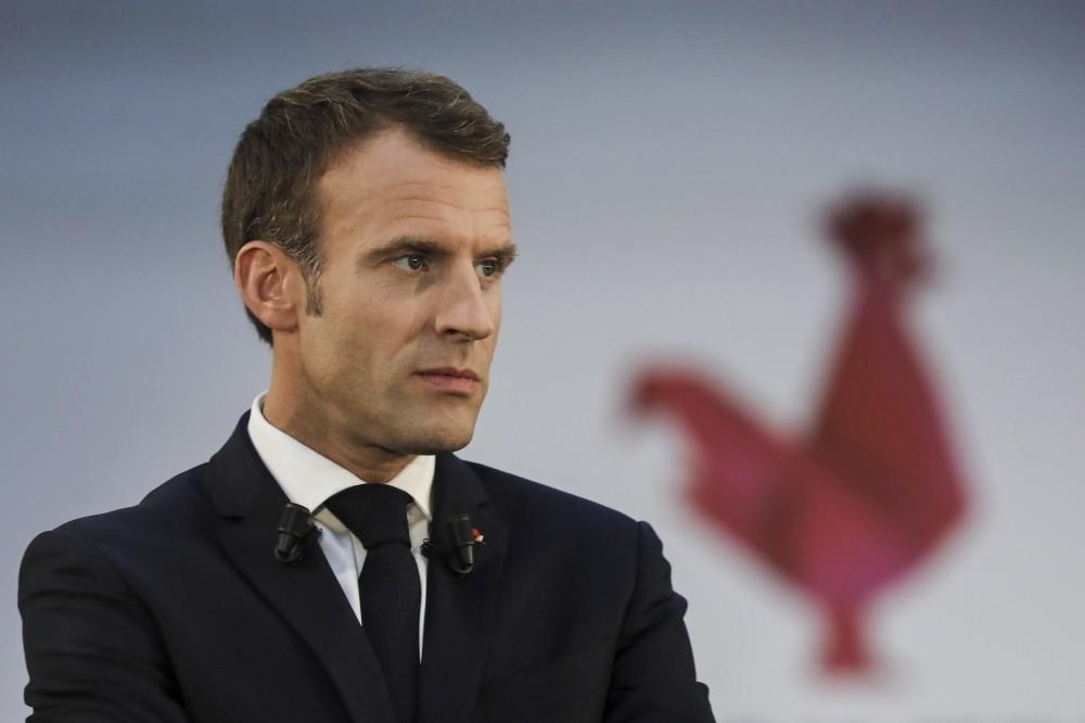 French President Emmanuel Macron addresses an audience, Paris, Oct. 9.